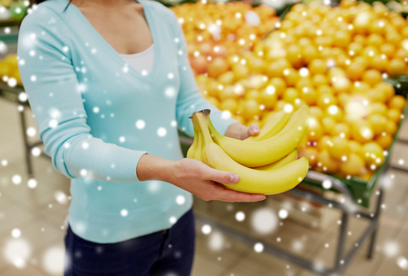 customer with bananas at grocery store