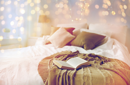 bedroom with bed and christmas garland at home Stock Photo