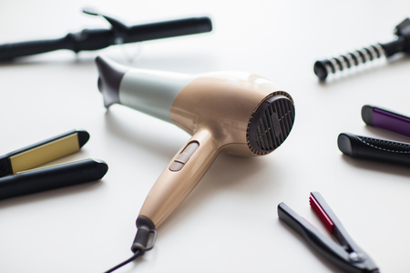 hairdryer, hot styling and curling irons Stock Photo
