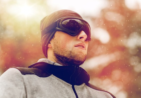 sports man with ski goggles in winter outdoors