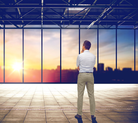 businessman thinking over office and city view