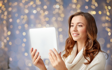 happy young woman with tablet pc at home
