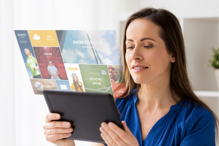 woman with tablet pc working at home or office