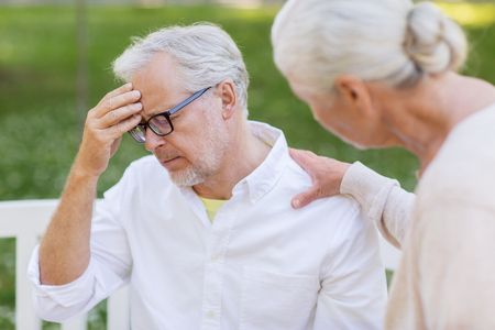 senior man suffering from headache outdoors