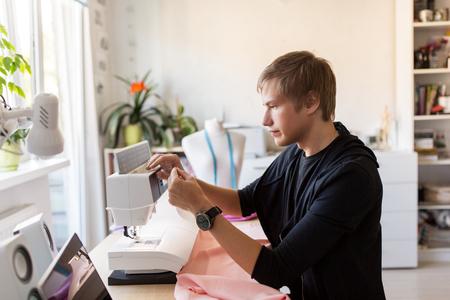 fashion designer with sewing machine at studio