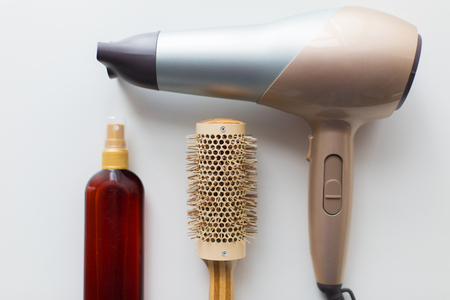 hairdryer, brush and hot styling hair spray Stock Photo