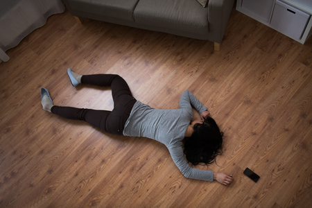 dead woman body lying on floor at crime scene