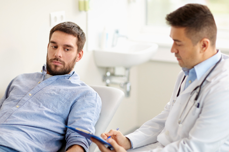 doctor and man with health problem at hospital Фото со стока