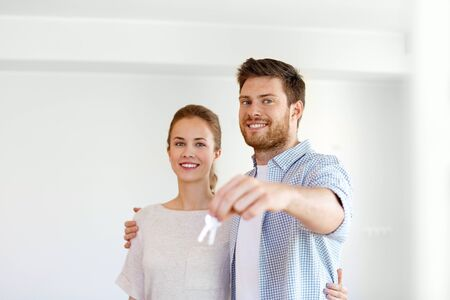 happy couple with keys of new home