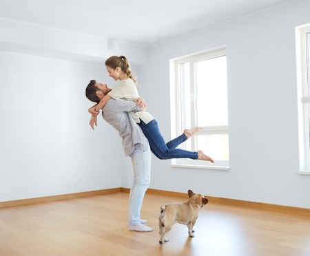 happy couple at empty room of new home Stock Photo