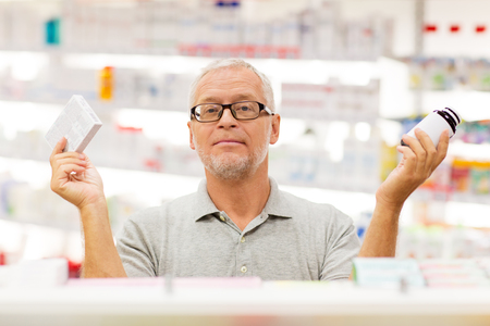 senior male customer choosing drugs at pharmacy Reklamní fotografie