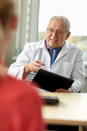 senior doctor and patient at womens health clinic Stock Photo