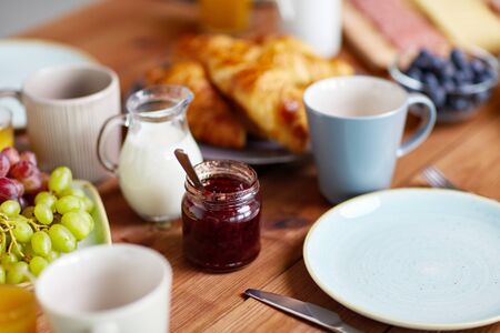 jar with jam on wooden table at breakfast Stock Photo