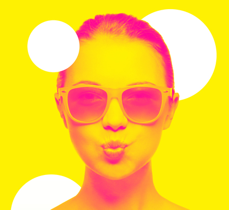 girl in pink sunglasses blowing kiss Stock Photo