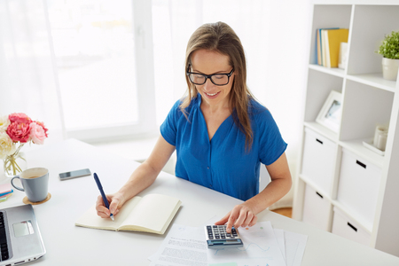 woman with calculator and notebook at office Stok Fotoğraf