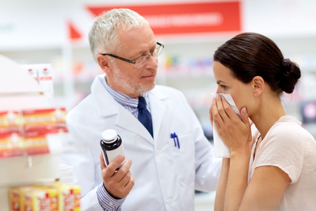 apothecary and sick customer at pharmacy Stock Photo