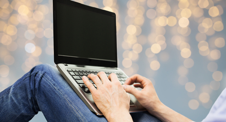 close up of man typing on laptop keyboard