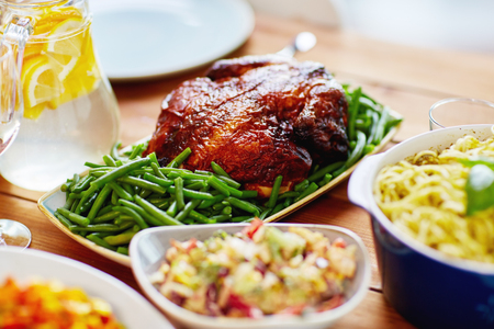 roast chicken with garnish of green beans on table