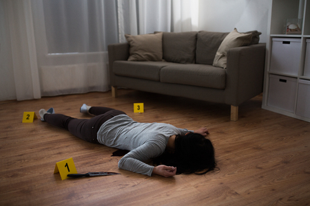 murder, kill and people concept - dead woman body and knife in blood lying on floor at crime scene (staged photo) Banque d'images