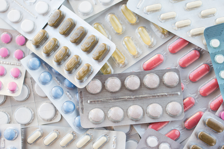 different pills and capsules of drugs