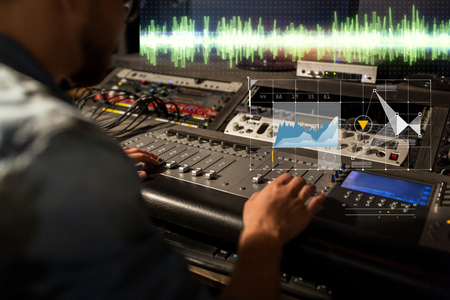 sound engineer at recording studio mixing console