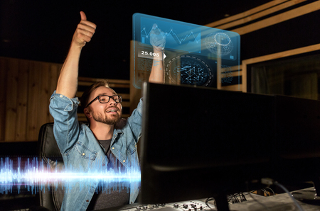 man at mixing console in music recording studio Stock Photo - 92018779