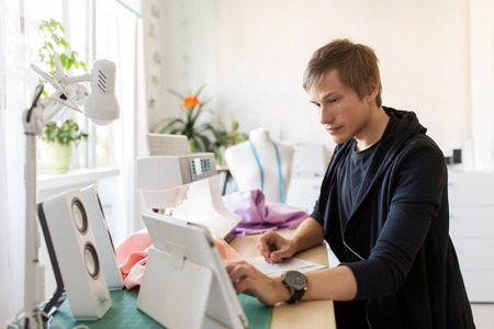 fashion designer with tablet pc working at studio Stock Photo