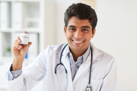 happy doctor with stethoscope and medication