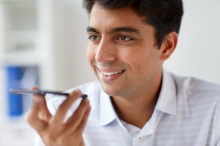 close up of man using voice recorder on smartphone
