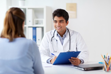doctor with clipboard and patient at hospital