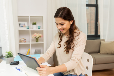 student or freelancer with tablet pc at home