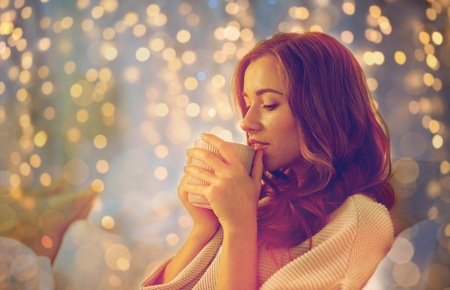 happy woman with cup of coffee in bed at home Stock Photo