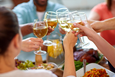 hands clinking wine glasses Stock Photo