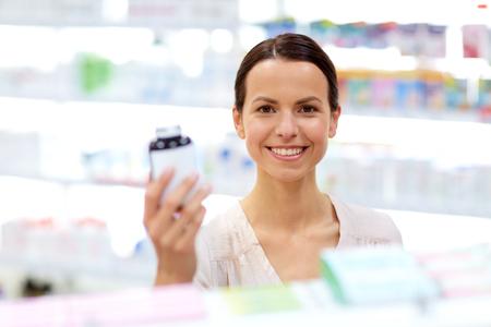 female customer choosing drugs at pharmacy