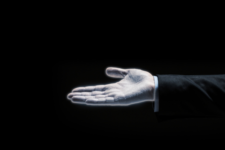 glowing businessman hand over black background