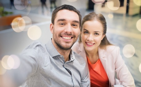 happy couple taking selfie in mall or office Banque d'images