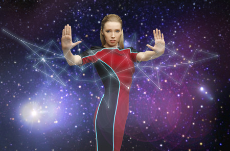 space, future and people concept - beautiful futuristic woman over planet and stars background