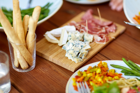 blue cheese and breadsticks on table Stock Photo