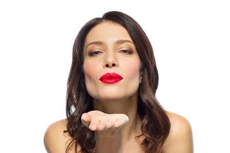 beautiful woman with red lipstick blowing air kiss Stock Photo