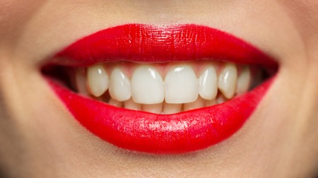 lips or mouth of smiling woman with red lipstick Stock fotó