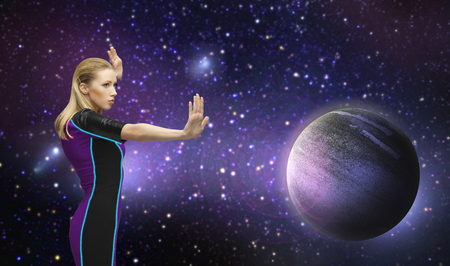 futuristic woman over planet and stars in space Stock Photo