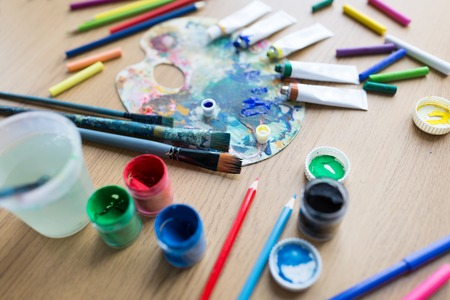 color palette, brushes and paint tubes on table Stok Fotoğraf - 94039809