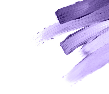 trendy design and makeup concept - close up of ultra violet paint smear sample