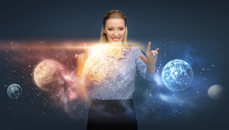 happy businesswoman with virtual planets and space Stock Photo