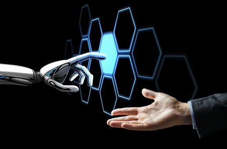 human hand and robot touching network hologram Archivio Fotografico