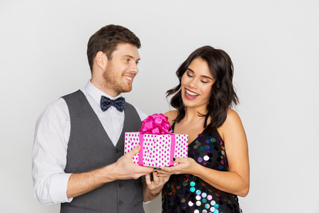happy couple with gift box at birthday party