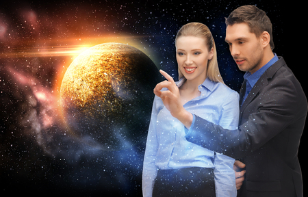 business, future and people concept - businessman and businesswoman with planet over space background Stock Photo