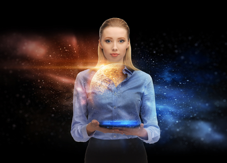business, future technology and people concept - businesswoman with tablet pc computer and planet hologram over space background