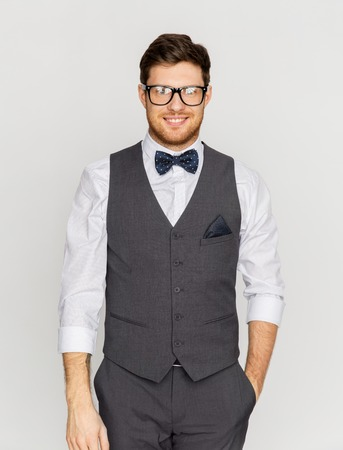 happy man in festive suit and eyeglasses