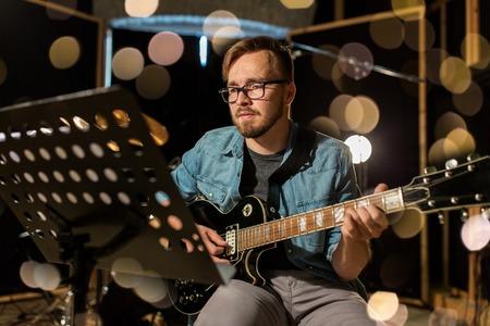 man playing guitar at studio rehearsal